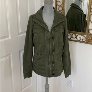 Green army jacket with distressed style